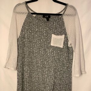 Grey knit shirt with white shoulders and pocket
